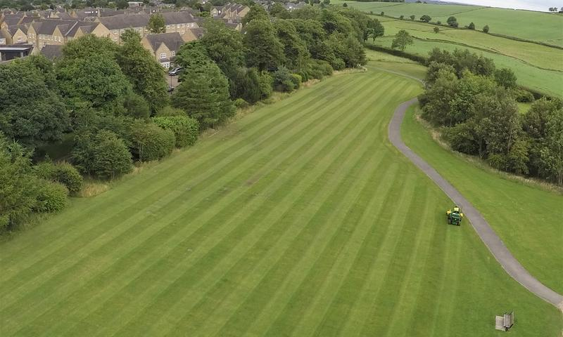 field showing lawn stripes during grass cutting in sheffield
