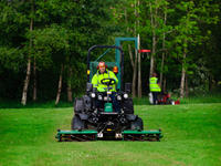 landscape contractors using both a Ransomes ride-on mower and pedestrian Honda mower